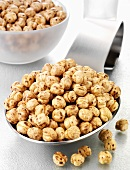 Roasted chick-peas on a spoon and in a glass bowl