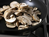 Sliced mushrooms in a frying pan