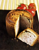 Pork pie with a portion removed (UK)