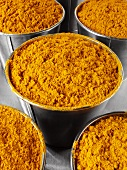 Ground turmeric in buckets
