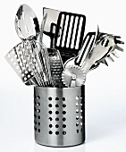 Various kitchen tools in a metal container