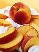 Whole peach and peach slices on cream