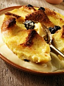 Bread and butter pudding with custard on a plate