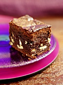 A chocolate nut brownie on plates