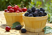Cherries and blackberries in wood chip baskets