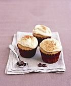Three espresso cupcakes with mascarpone cream
