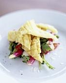 Deep-fried squid on radish and spring onion salad