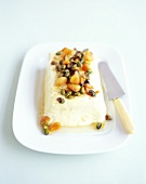 Lemon curd ice cream parfait with dried apricots, pistachios
