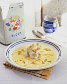 Poached meringue with custard, caramel and almonds