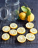Lemon slices sprinkled with salt ready for pickling
