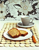 Two slices of pineapple cake with a cup of tea