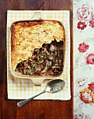 Artichoke and mushroom pie in a baking dish