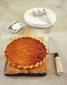 Treacle tart on chopping board (UK)
