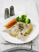 Poached skate wing with caper butter and vegetables
