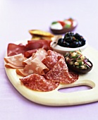 Appetiser board with tapas and salami