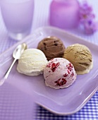 A scoop of vanilla, chocolate, caramel and raspberry ice cream