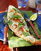Sea bass in sesame crust on a banana leaf