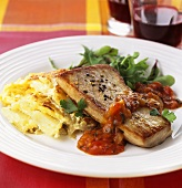 Fried tuna with tomato sauce and potatoes au gratin