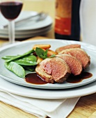 Saddle of lamb with gravy and vegetables