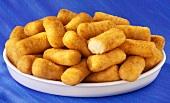 Potato croquettes in white dish