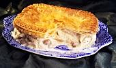 Chicken and mushroom pie, a portion taken