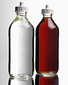 Two different bottles of vinegar