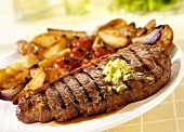Grilled beef steak with roast potatoes