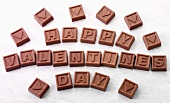Chocolate squares with letters spelling 'Happy Valentine's Day'