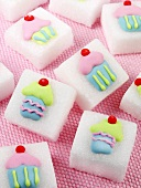 Sugar cubes decorated with cupcakes