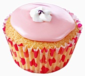 Cupcake with pink icing and white sugar flower