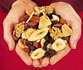 Hands holding trail mix