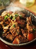 Spicy lamb stew with tomatoes