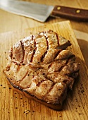 Grilled pork steak on chopping board