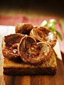 Spicily seasoned lamb kidneys on fried bread