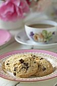 Chocolate chip and coconut biscuits with tea
