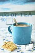 Mug of tea, malted milk biscuits and sugar cubes (UK)