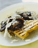 Grilled polenta slices with mushrooms and Parmesan