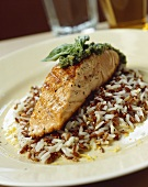Grilled salmon fillet with pesto and lemon rice
