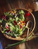 Mixed salad with edible flowers and a maple and chive dressing