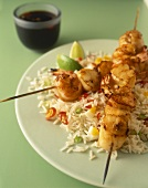 Seafood kebabs on a bed of rice