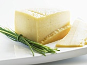 A piece of Parmesan with chives