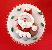 Cupcake with fondant icing and a sugar Father Christmas