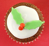 Chocolate cupcake with holly leaf decoration