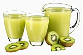 Kiwi fruit juice in jug and two glasses & fresh kiwi fruit