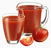 Tomato juice in jug and glass and fresh tomato