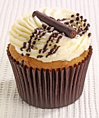 A chocolate cupcake with butter cream