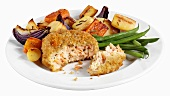Fish cake with roasted vegetables and beans