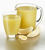 Banana juice in glass and jug