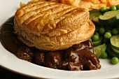 Beef pie with mashed sweet potato and vegetables