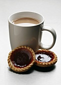 Tea with milk, jam tarts